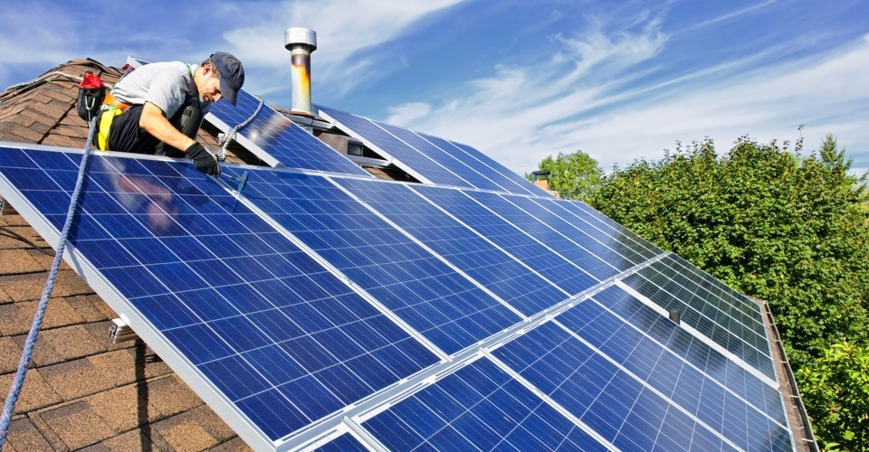 man installing solar on residential roof in ohio